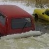 Funny Pictures - Ice Swallows Cars